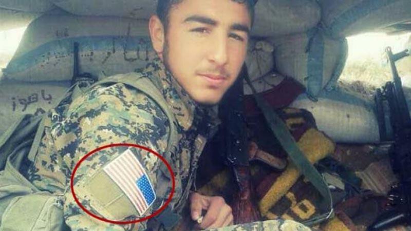 PYD militanlarının omzunda ABD bayrağı